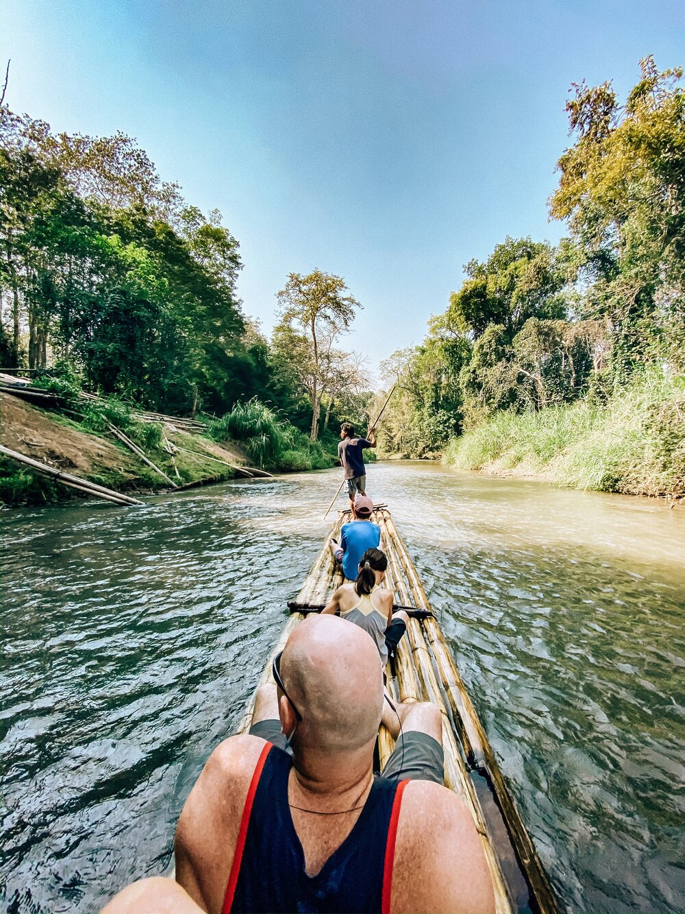 Family activity bamboo river rafting in Thailand