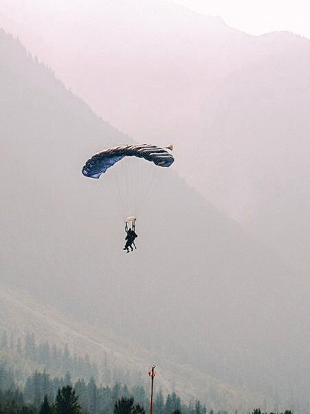 Skydiving parachute in Canadian mountains